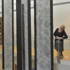 Hocken Collections pictorial head curator Robyn Notman admires Ralph Hotere's Rain banners just...