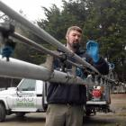 Toko Spraying contractor Rod Murdoch inspects a spray boom nozzle before work. Photo: Stephen...