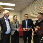 National's agriculture spokesman Nathan Guy (centre) and Invercargill MP Sarah Dowie, talk with...