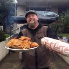 Dave Neilson, of Dunedin, celebrates ''Bacon Day'' with friends on Friday last week with pork...