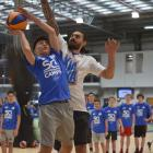 Steven Adams in action with Waitaki Boys' High School pupil Danyon Ashcroft (14) at the Edgar...