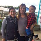 Awarua Whanau Services registered nurse Cara Morton and Stewart Islander Karin Lewis with son...
