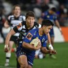 No 10 for Otago, Josh Ioane crosses the line to score in the first half as No 10 for the Hawkes...