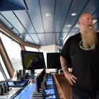 The captain of Sealord's vessel Tokatu, Rex Chapman, at the trawl gear controls on the ship's...