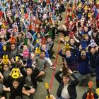 School pupils, mainly year 5 to year 8, give a mass ukulele salute at the Tahuna Normal...