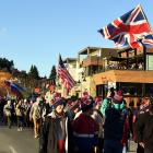 Faith Davis waves her Great Britain flag as she leads the Winter Games parade past the Wanaka...