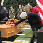 Kathy Wright, sister of Corporal Allister George Buchanan, says farewell at the graveside in...