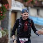 Glenn Kelly celebrates with a spectator during the Tor des Geants ultra running event, which he...