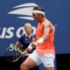 Rafael Nadal celebrates a third set winner against Nikoloz Basilashvili. Photo: Robert Deutsch...