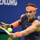 Rafael Nadal hits a return to Dominic Thiem. Photo: Danielle Parhizkaran-USA TODAY SPORTS