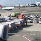 Emergency services on hand after the airliner landed at JFK Airport in New York. Photo:  Larry...