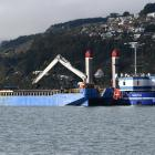 Port Otago's $8million backhoe dredge Takutai works in the upper reaches of Otago Harbour in July...