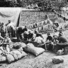 Twenty men, 45 years of age or older, wash 4000 pairs of socks daily for the troops at the front....