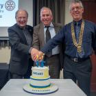 Cutting the 75th anniversary cake for the Rotary Club of Alexandra on Saturday are (from left)...
