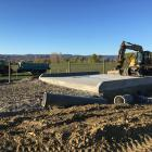 Heavy machinery sits on the construction site of the Otago Regional Council's latest stock truck...