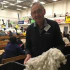 New Zealand Merino Shearing Championships committee member Graeme Bell looks over some of the...