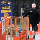 Smiths Sport Shoes co-owner Greg Lapwood says he is losing about $1000 a week because of the...
