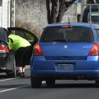 Police check car seats in North Dunedin this week. Photo: Gregor Richardson