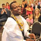 New citizen Robert Fugah, originally from Ghana, performs a traditional African drum song in...