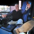 Go Bus Dunedin depot manager Colin Abbis (64) hands back the keys yesterday after 43 years in the...