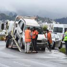 A vehicle rolled on the 35km corner near Vauxhall this morning. Photo: Stephen Jaquiery