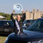 Tim Price poses with his trophy after winning the Burghley Horse Trials in Stamford, Lincolnshire...