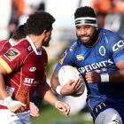 Joketani Koroi of Otago looks to bust through the Southland defence in Invercargill today. Photo:...