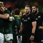A dejected looking Kieran Read and Sam Whitelock look on as South Africa celebrate. Photo: Getty...