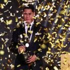 Roger Tuivasa-Sheck holds the trophy after being announced as the Dally M medal winner in Sydney....