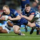 Otago centre Matt Faddes evades the tackle of Auckland loose forward Dalton Papali'i to score one...