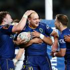 Matt Faddes of Otago celebrates with teammates after scoring a try during the round seven Mitre...