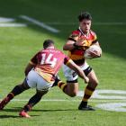 Southland wing Isaac Te Tamaki prepares to tackle Waikato centre Quinn Tupaea during their  Mitre...