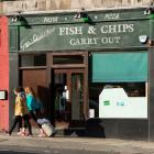 The Leith Walk in Edinburgh, where small family-run businesses such as this are being replaced by...