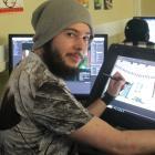 Game developer Nik Bartlett (20) works on his endless-runner game Supreme Mech Panda for the...
