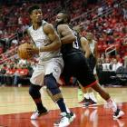 Minnesota Timerwolves swingman Jimmy Butler makes a move as he is guarded by Houston Rockets'...