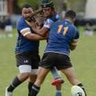 Otago Whalers Louis Tili (left) and Jong Hoon Lee knock the ball free from the hands of Northern...