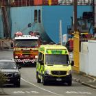 A Port Otago worker, who was injured after being struck by a container,  is taken by ambulance to...