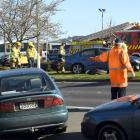 A man was injured after the elderly driver he was directing out of a Mitre 10 car park reversed...