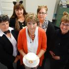 Norma McLeod (centre) surrounded by her colleagues on her last day of work at the Oamaru division...