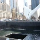 The dove-like wings of the Oculus building are pictured behind one of the two memorial pools that...