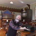 New Zealand Organ Museum Trust member Dr Ron Newton tickles the ivories of a mid-19th century...