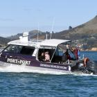 The first passenger ferry on Otago Harbour in more than 60 years takes company and Dunedin I-SITE...