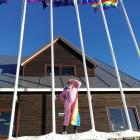 Cardrona staff member Bindy Doust salutes Winter Pride on the mountain yesterday. Photo: Cardrona...