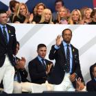 Patrick Reed and Tiger Woods react at the Ryder Cup opening ceremony. Photo: Getty Images