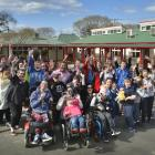 Sara Cohen School pupils, staff and friends show their approval after hearing the school is in...