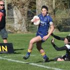 Otago Spirit fullback Sheree Hume is about to score, brushing aside the tackle of her opposite,...