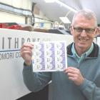 Southern Colour Print managing director Sean McMahon with some of the 84,000 new women's suffrage...