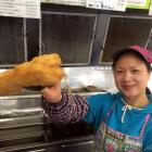 Gold Star Takeaways co-owner Minnie Yan presents a deep-fried cheese roll in her shop in Bradford...