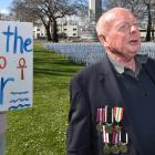 Waikouaiti man Don Kendall at Queens Gardens shortly before a 1080 protest on Saturday. He...