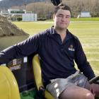 University of Otago Oval turf manager Jayden Tohill does some top dressing at the venue yesterday...